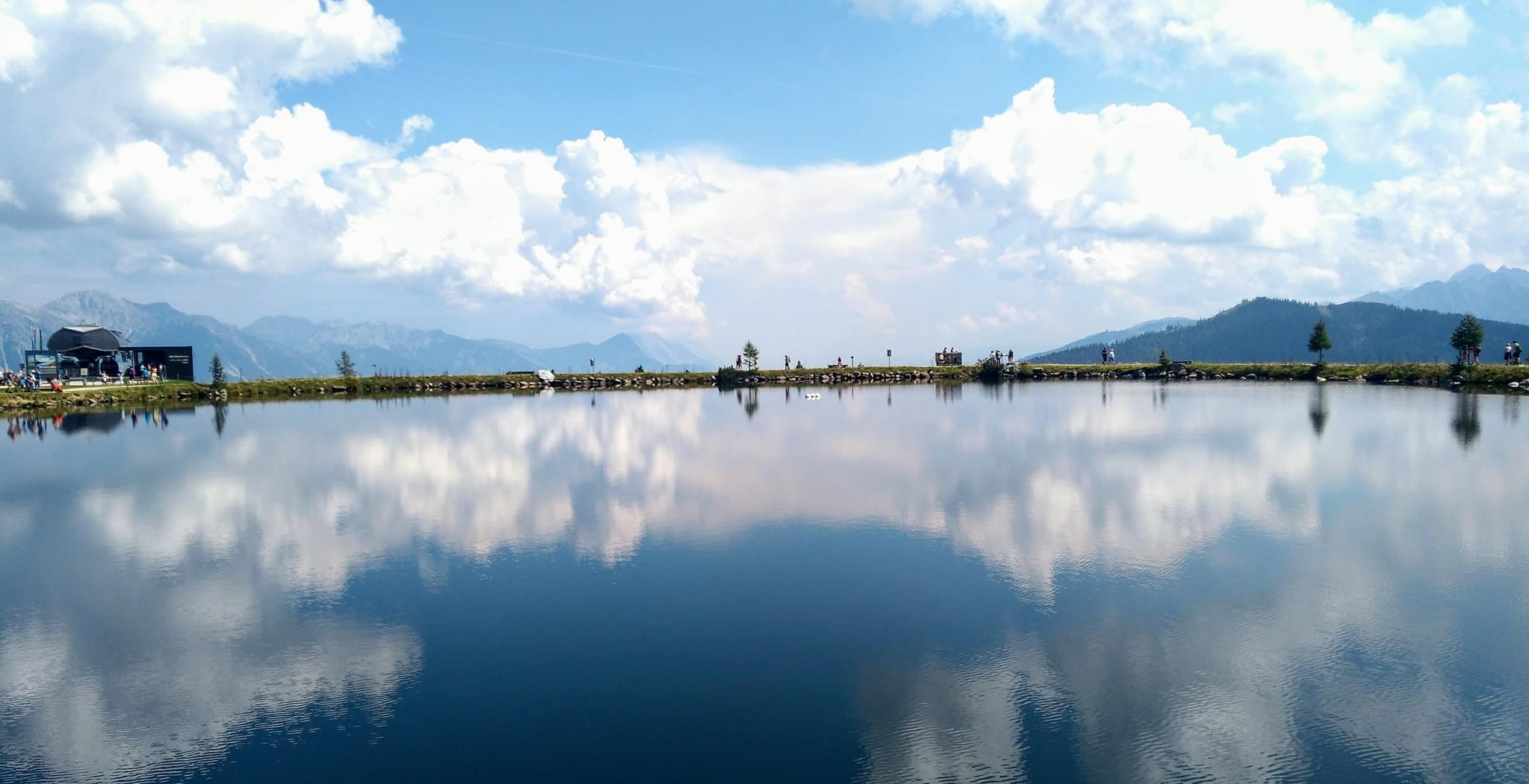 Blue sky and clouds reflected in quiet water